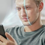Mobile phone scanning man's face