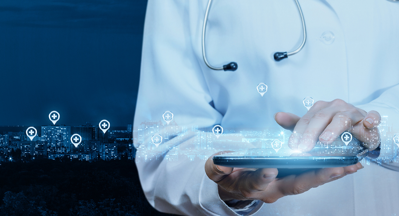 Doctor working at the medical network on the tablet at the background of the city.